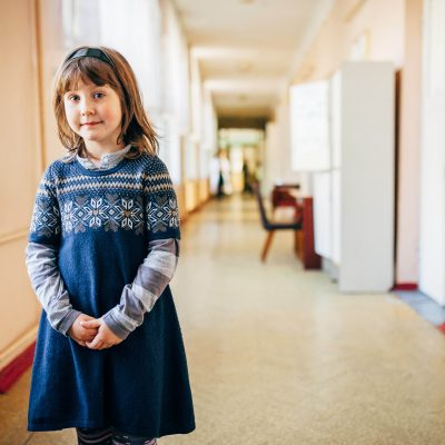 On 7 October, 8-year-old Vika, who has been displaced from the city of Horlivka in Donetsk Luhansk Oblast (Region), stands in a corridor at an accommodation centre for people displaced by the countryís continuing conflict, in the Pushcha Vodytsia neighbourhood in Kyiv, the capital. Vika and her mother fled from Horlivka to a nearby city when the fighting began. However, her mother has had to return to their home city in order to work. Vika misses going to school very much and, despite the ongoing fighting, hopes to return to Horlivka and to school. Some 40 displaced children from areas affected by the conflict are currently living at the accommodation centre.  By 13 October 2014 in Ukraine, at least 3,682 people had been killed and 8,871 had been wounded in the countryís continuing conflict. More than 402,000 people have also been internally displaced, and an estimated 5.1 million people are living in conflict-affected areas. Over 427,000 people have also sought refuge in neighbouring countries. The fighting has destroyed or disrupted essential infrastructure and basic services, leaving affected populations vulnerable and in need of urgent support. Ongoing insecurity and a lack of safe access are also hampering the provision of humanitarian aid. Despite the current ceasefire, serious ceasefire violations continue to be reported daily, and shelling has intensified in areas in Donetsk and Luhansk oblasts ñ two of the five provinces most affected by the conflict. In response to the continuing fighting, UNICEF is supporting health, nutrition, water, sanitation and hygiene (WASH), education, and child protection interventions, including: the provision of vaccines and essential medicines; the distribution of drinking water and ongoing water treatment to provide safe water; the delivery of child and adult hygiene kits, early childhood development (ECD) kits and school kits; and the establishment of child-friendly spaces to provide psychosocial support for children